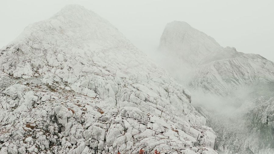 Scenice View Of Jade Dragon Snow Mountain In Fog