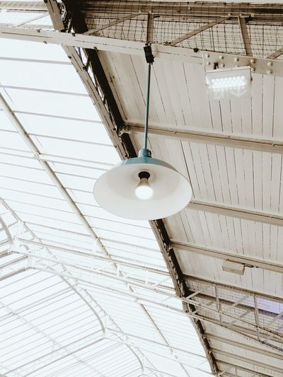Low angle view of pendant light on roof