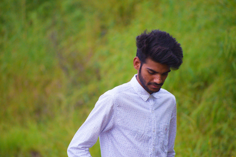 EyeEm Best Shots EyeEm Gallery Looking Down Beard Day Formalwear Green Background Greenery Hairstyle Headshot Nature One Person Outdoors People Portrait Standing White Shirt Young Adult