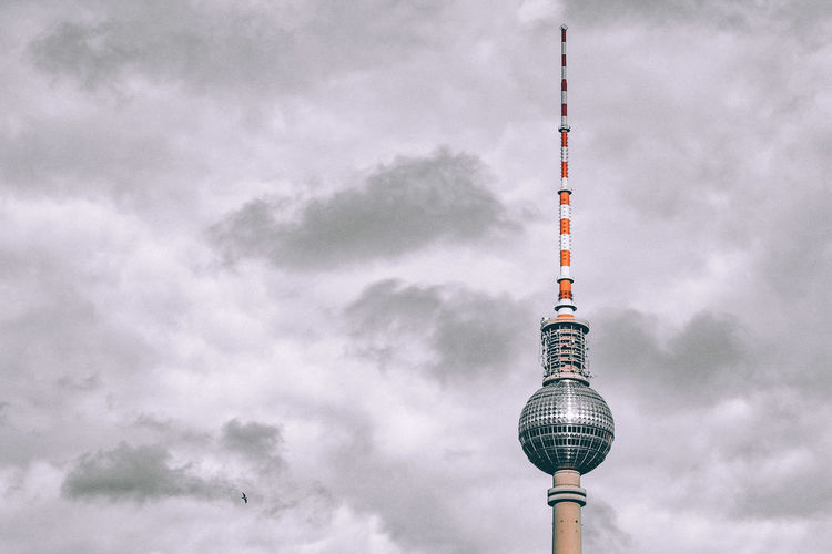 Berlin television tower against cloudy sky