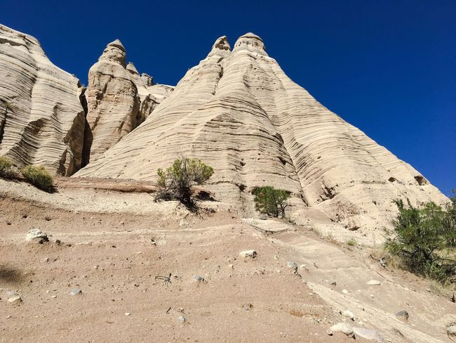Low Angle View Clear Sky Blue Tranquil Scene Rock Formation Physical Geography Geology Tranquility Scenics Eroded Nature Solitude Outdoors Sunny Beauty In Nature Tourism Remote Arid Climate Day Sky Kasha-Katuwe Tent Rocks National Monument USA Nature Travel Destinations Miles Away