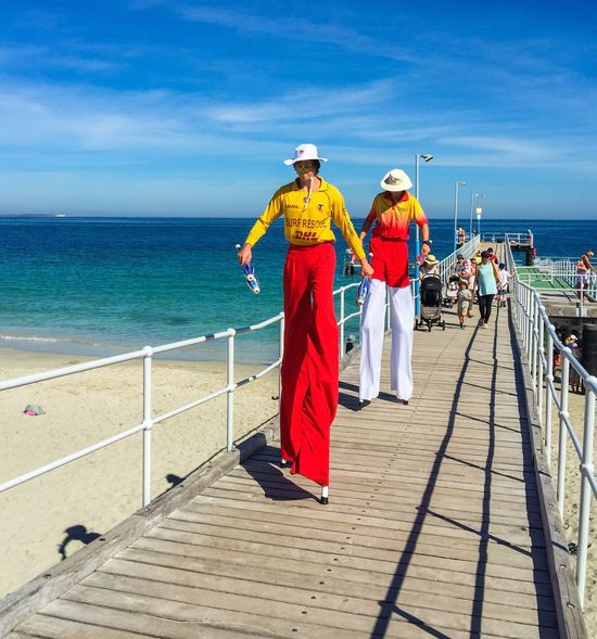 Stilt Walkers on the Jetty Stilts Stiltwalkers Performers Jetty Coogee Beach Festival Western Australia Beach Indian Ocean Event Festival Entertainment Turquoise Water Seascape Incidental People Families April 3,2016 Coogee, WA Fun Sand Coastal Life Recreation  Tall Balance Surf Rescue Lifeguards