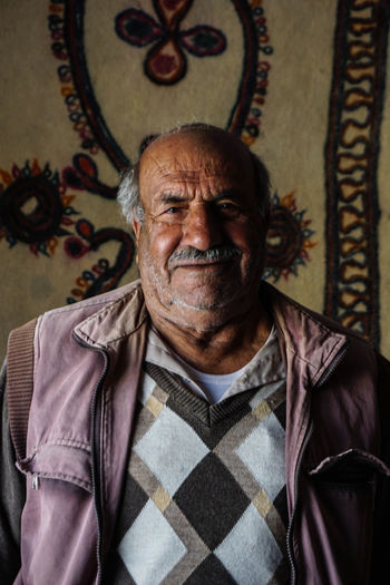 Travel Destinations Travel Photography Iran Shia Community Nomadic Zoroastrian Islamic Architecture One Person Smiling Portrait Indoors  Adult Looking At Camera Emotion Happiness Front View Facial Hair Beard Clothing Senior Adult Mature Adult Headshot Waist Up Mustache Respect