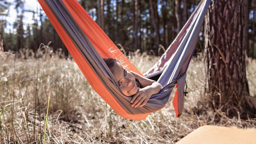 Portrait of girl lying on hammock