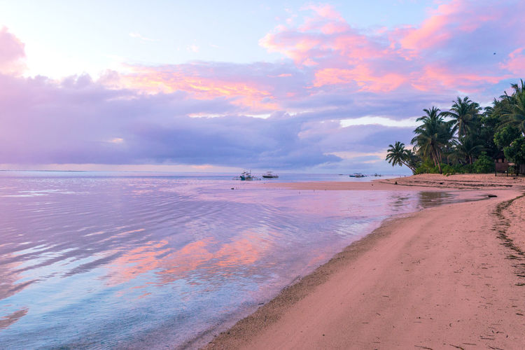 Beautiful sunrise on Bantayan Island Calm Morning Nature Philippines Reflection Scenic Travel Beach Beauty In Nature Clouds Colorful Dawn Idyllic Landscape Ocean Palm Trees Sandy Sea Shore Sunrise Travel Destinations Water