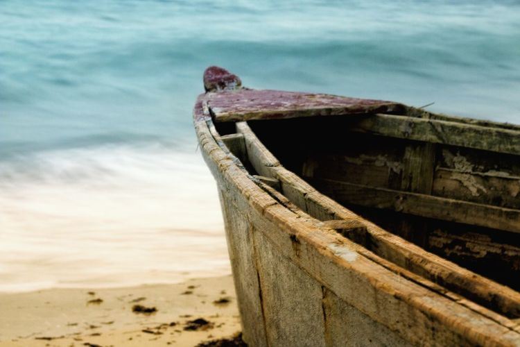 Close-up of old boat on beach