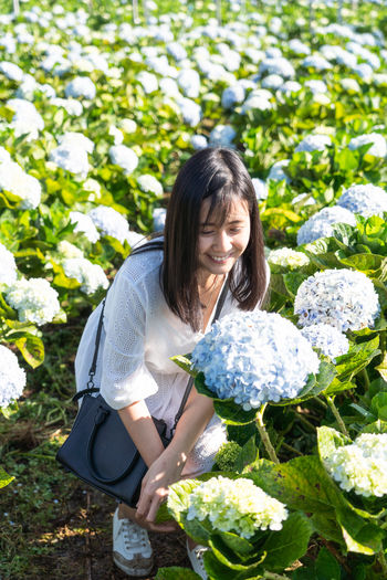 Travel ASIA Asian  Thailand Thai Hydrangea Flower Hydrangea Portrait Plant One Person Flower Casual Clothing Nature Day Flowering Plant Women Leisure Activity Front View Lifestyles Long Hair Hairstyle Holding Hair Happiness Growth Smiling Three Quarter Length Outdoors