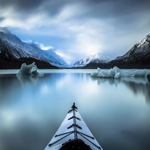 Kayak On Lake In Mountains In Winter