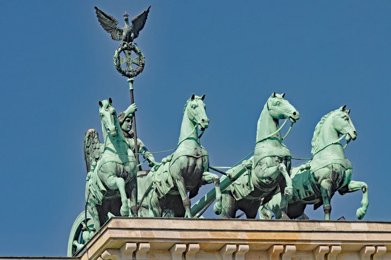 Low angle view of quadriga against clear sky