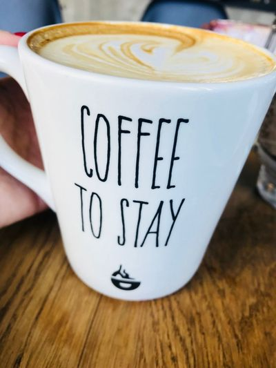 Cappuccino Close-up Coffee Coffee - Drink Coffee Cup Communication Crockery Cup Drink Food And Drink Frothy Drink Hot Drink Indoors  Latte Message Mug No People Non-alcoholic Beverage Refreshment Still Life Table Text Western Script