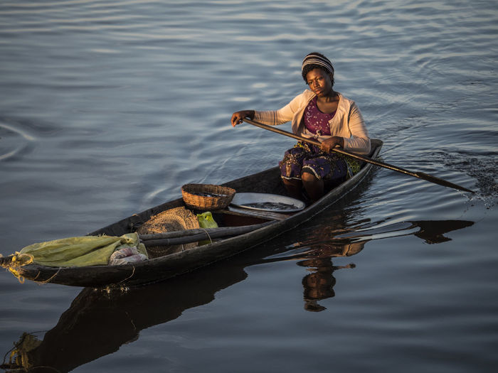 High Angle View Of Woman Sitting On Rowboat In Lake