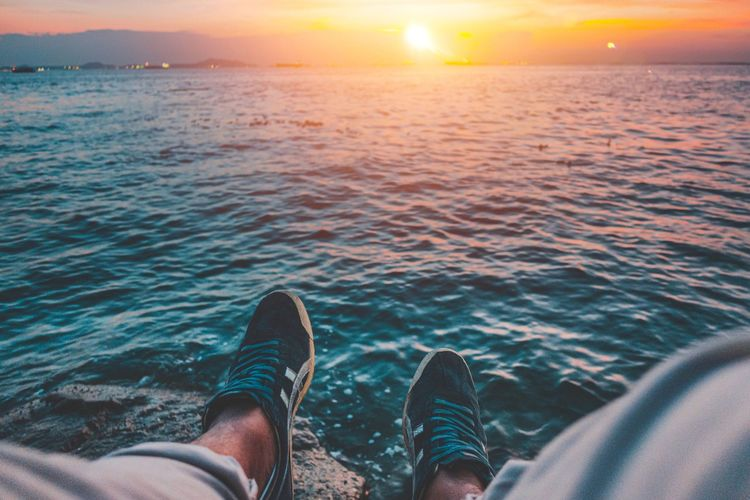 Legs Leg Low Section Shoe Sunset Sea Body Part Human Leg Water Lifestyles Sky Personal Perspective Nature One Person Horizon Over Water Horizon