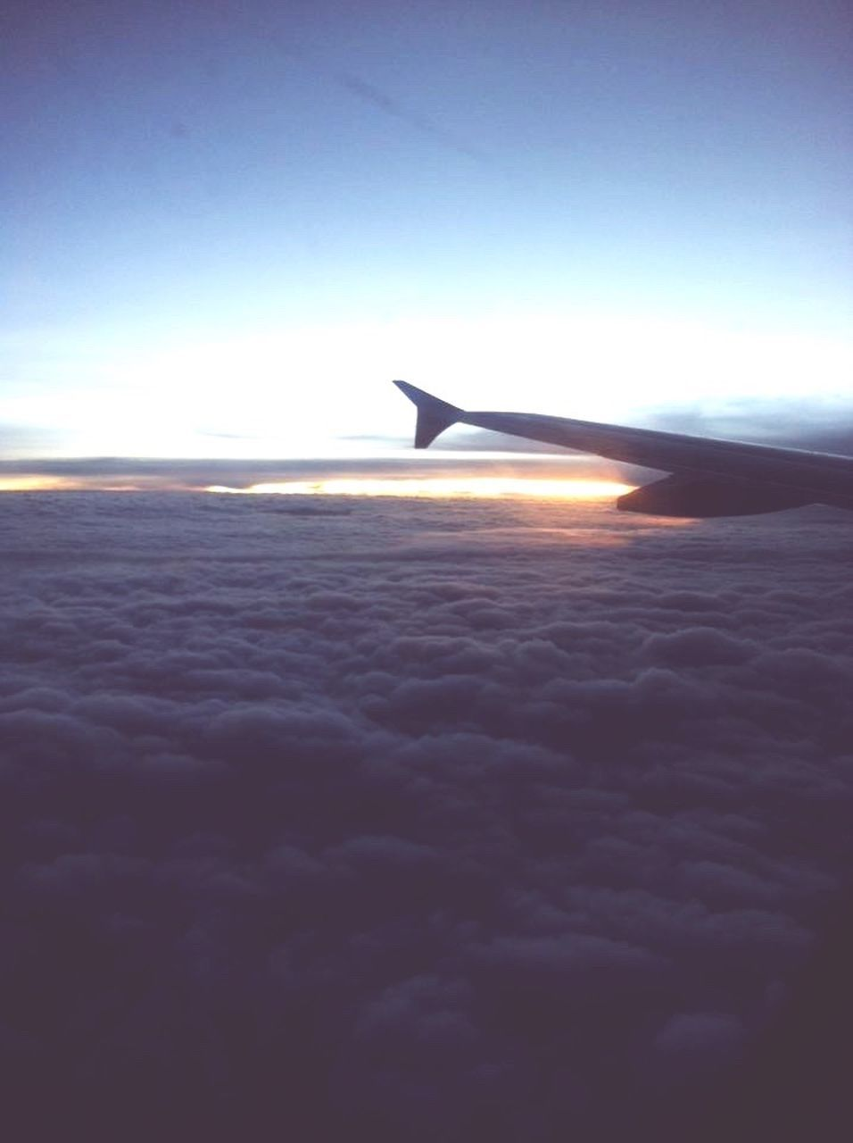 airplane, transportation, airplane wing, sky, cloud - sky, nature, aerial view, journey, beauty in nature, scenics, travel, no people, sunset, air vehicle, mode of transport, sea, tranquility, flying, mid-air, outdoors, aircraft wing, blue, day, the natural world, water, horizon over water