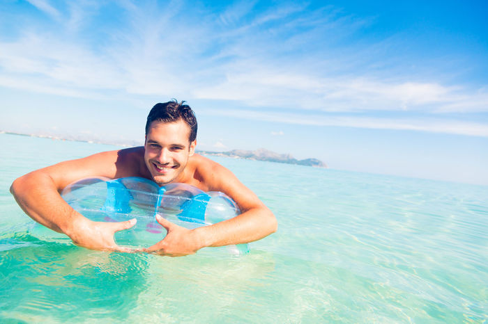 Blue Cheerful Enjoyment Happiness Horizon Over Water Leisure Activity Lifestyles Looking At Camera Mediterranean  Mediterranean Sea Men Nature One Person Outdoors Pool Raft Raft Relaxing Sea Smiling Sunbathing Tourist Vacations Water Waterfront Weekend Activities