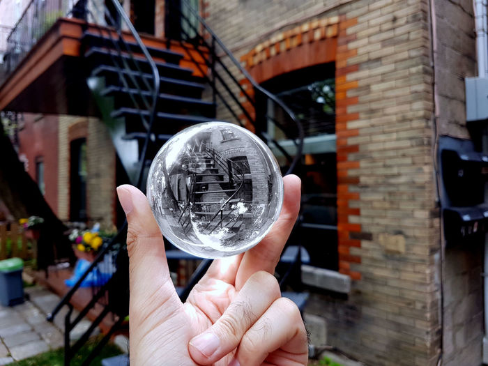 Midsection of person holding crystal ball