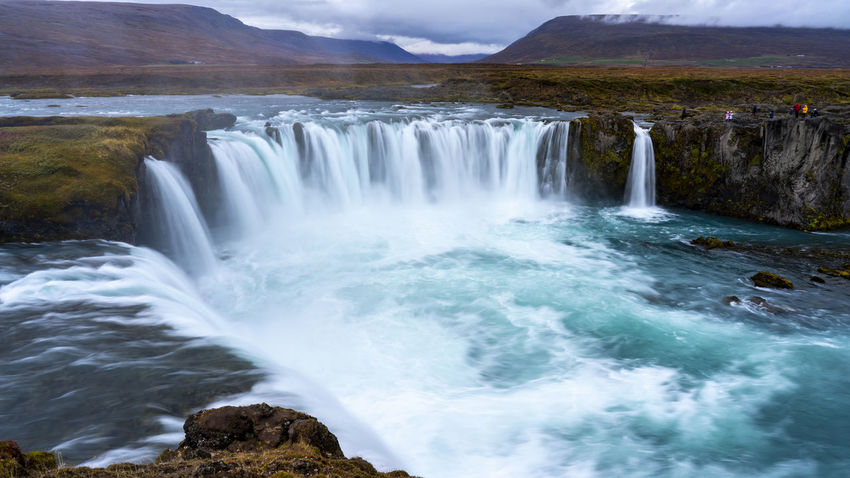 The Goðafoss is a waterfall in Iceland. It is located in the Bárðardalur district of Northeastern Region at the beginning of the Sprengisandur highland road. The water of the river Skjálfandafljót falls from a height of 12 meters over a width of 30 meters. Scenics - Nature Water Beauty In Nature Waterfall Motion Long Exposure Nature Flowing Water No People Outdoors Power In Nature Flowing Goðafoss Waterfall Sunrise Sunset Environment Blurred Motion Majestic Beauty In Nature Horseshoe Falls Rocks Land Power River Rock Forest Sport