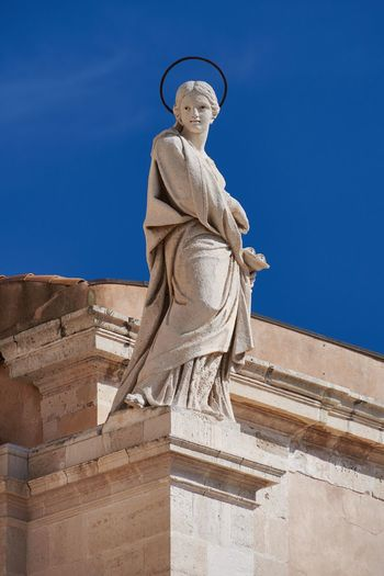 Duomo di Siracusa, Sicily Blue Sky Italy Sicily Syracuse  Siracusa Statue Saint Halo Sculpture Religious Art Religious Architecture Church Cathedral Human Representation No People Textures And Surfaces Weathered Stone Material Stone History Historic