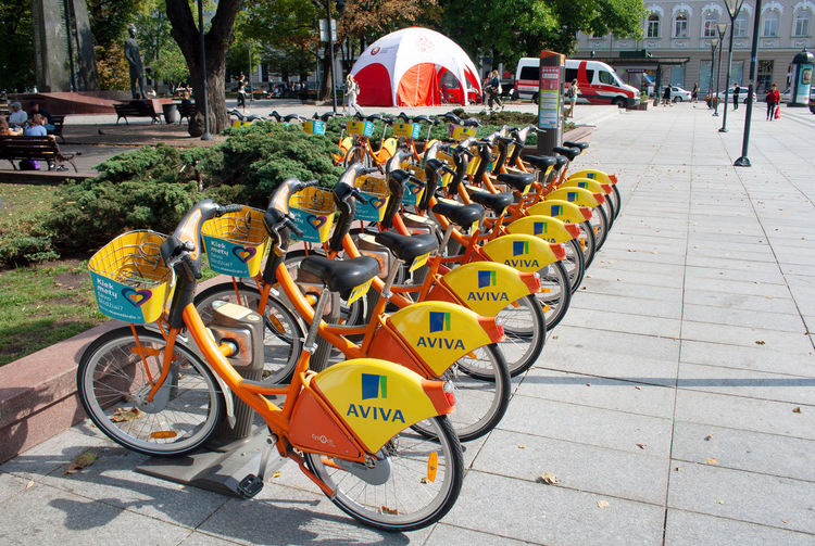 """City Bike Rental - A row of bikes parked for hire as part of a new scheme to encourage """"pedal power"""" in Vilnius, Lithuania City Green City Green Color Lithuania RENT Vilnius Bicycle Bike Bike Rental City Clean Work Environment Clean World Day Green World Hire Land Vehicle Mode Of Transportation No Smog Outdoors Rental Road Row Smog Street Transportation"""