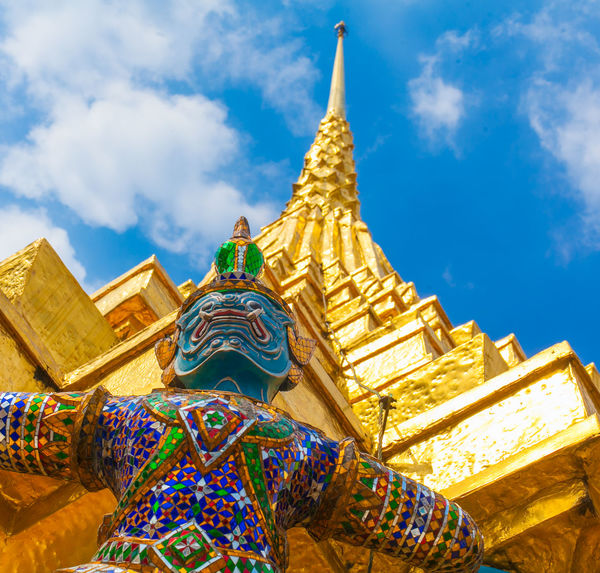 giant and pagoda wat pra keaw bangkok thailand Architecture Bangkok Building Exterior Built Structure Cloud - Sky Day Gold Gold Colored Golden Golden Color Low Angle View Multi Colored One Person Ornate Outdoors Place Of Worship Religion Sky Spirituality Statue Travel Destinations Wat Prakeaw Wat Prakeaw Bangkok
