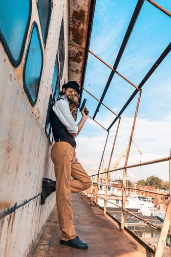 Man using mobile phone against sky