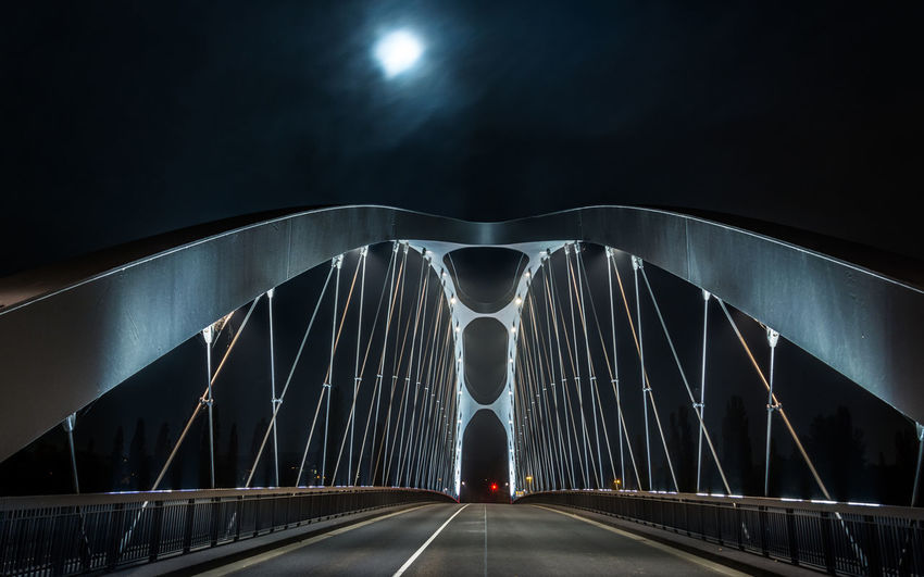Rear view of bridge against sky at night