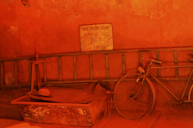 Old rusty bicycle against wall
