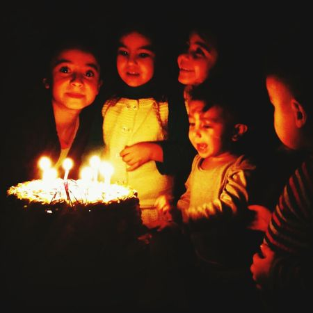Child Girls Night Males  Portrait Looking At Camera Family Boys Females Childhood Dark Elementary Age Burning Flame Group Of People People Illuminated Togetherness Adult Turkeyphotooftheday Turkey Dogumgununkutluolsun Cocuklar Traveling Home For The Holidays Welcome To Black