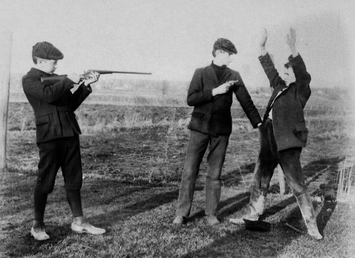 Glass plate negative from the 1930s, scanned and inverted in Photoshop 1930 Antique Black And White Film Negative Full Length Glass Plate Gunpoint Hands Up Don't Shoot Hold Up Inverted Image Old-fashioned Outdoors People Riffle Robbery