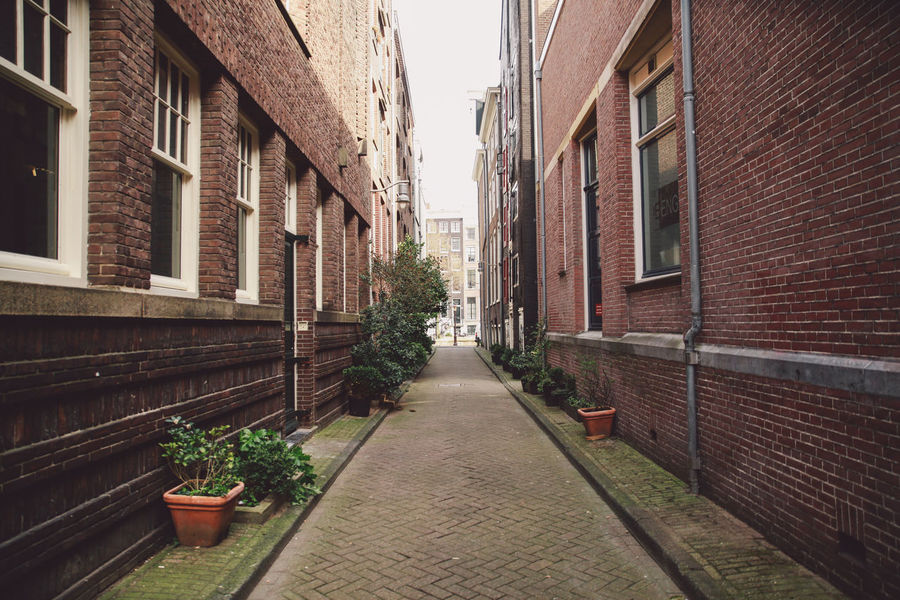2016 Alley April Architecture Building Building Exterior Built Structure City City Life Diminishing Perspective Empty Footpath Long Narrow No People Outdoors Residential Building Residential District Residential Structure Spring The Way Forward Town Vanishing Point Walkway Your Amsterdam