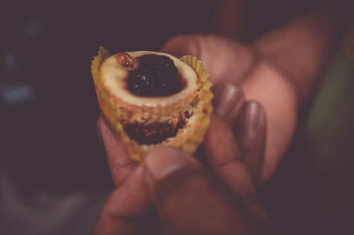 Mini blueberry cheesecake. Adult Adults Only Blueberry Cheesecake Celebration Cheesecake Christmas Close-up Cupcakes Dessert Food Food And Drink Freshness Healthy Eating Holding Holiday Human Body Part Human Hand Muffin One Person Peeling People Ready-to-eat Snack Sweet Food Temptation