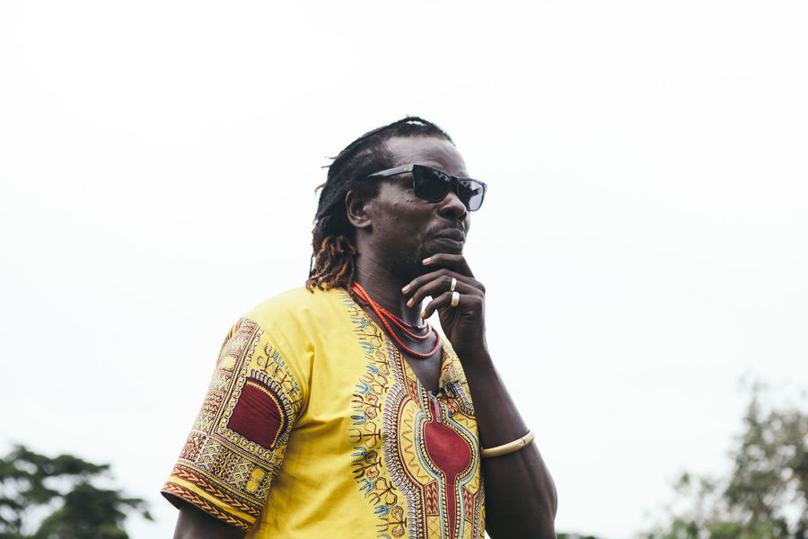 Adult Adults Only Africa African Contemplation Cultures Day Dreadlocks Jewellery Low Angle View Man Men One Man Only One Person Only Men Outdoors Patterns People Portrait Real People Strong Sunglasses Thinking Traditional Clothing Waist Up