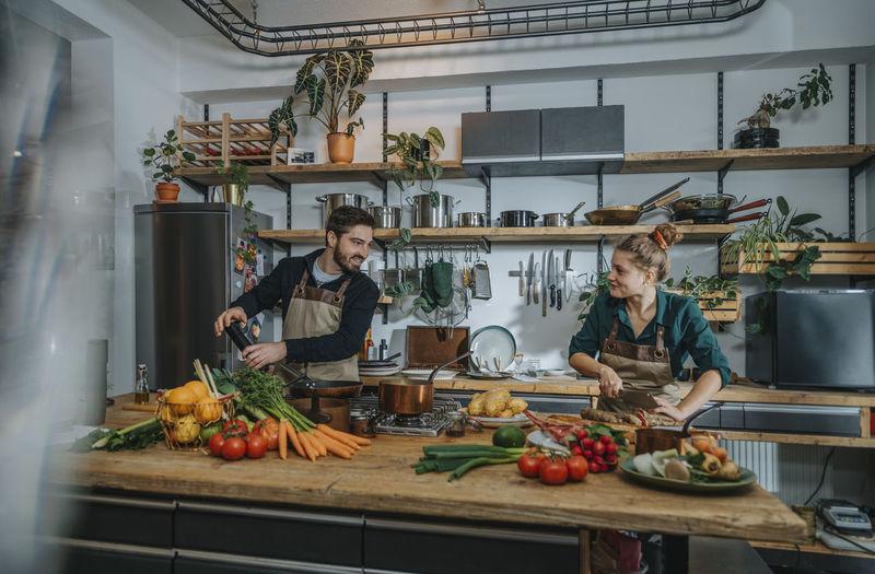 Young man preparing food on cutting board