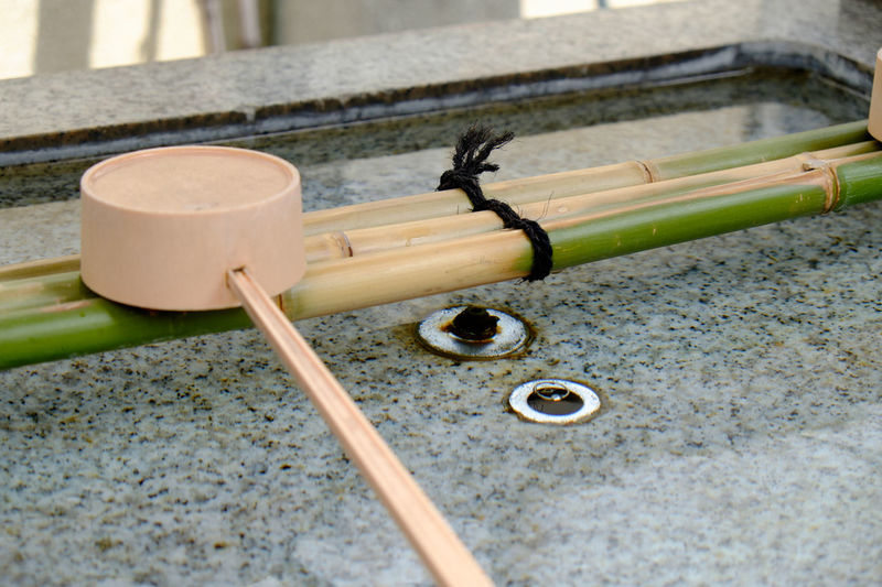 Wooden ladle on japanese drinking fountain