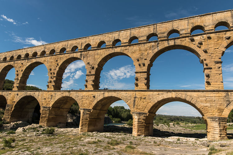 Ancient Ancient Civilization Aqueduct Arch Architecture Built Structure Clear Sky Day France History Low Angle View Nature No People Old Ruin Outdoors Pont Du Gard Provence Provence-Alpes-Cote D'Azur Roman Empire Sky Sunlight Travel Destinations