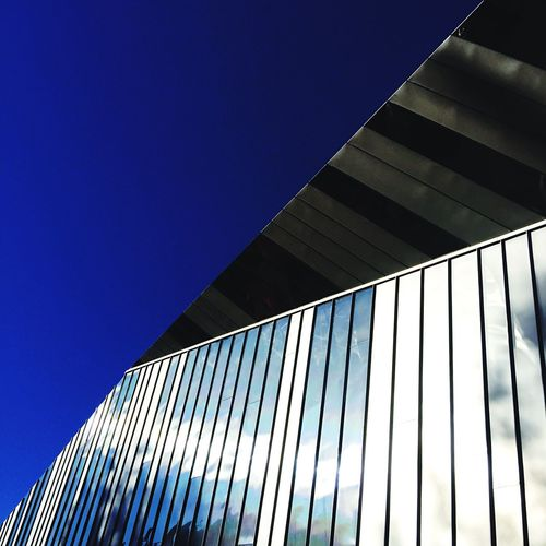 Architecture Built Structure Low Angle View Modern Building Exterior Blue No People Day Clear Sky Sunlight Sky Architecture_collection Architectural Detail Streetphotography Street Photography Taking Photos IPhoneography Design Urbanphotography Metal Lookingup
