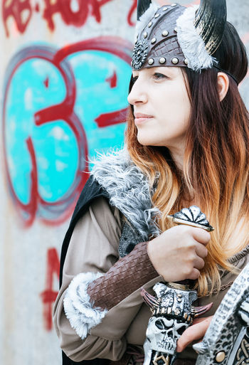 Viking lady. Viking Viking Costume Costume Young Women Portrait Beautiful Woman Fashion City Street Art Graffiti Close-up Carnival Carnival - Celebration Event Mask - Disguise Superhero Disguise