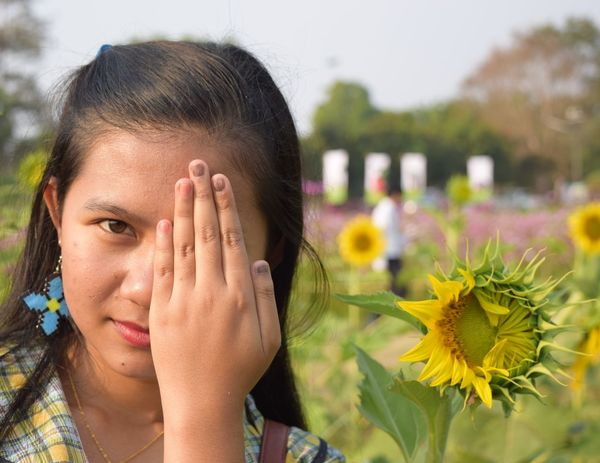 Girl and blooming sunflower Summer Summertime Spring Springtime Outdoor Girl Sunflower Blooming Blooming Flower Portrait Flower Headshot Close-up Posing Head In Hands