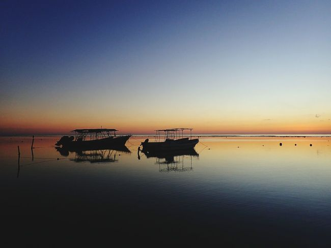 EyeEm Selects Reflection Sunrise CARIBBEANLIFE Shotzdelight Wanderlust Fishing Boat Silhouette Tranquil Scene New On Eyeem Fishing Boats Tranquility Silhouette Nature Water Sky Beauty In Nature Outdoors No People Scenics Clear Sky Nautical Vessel Day