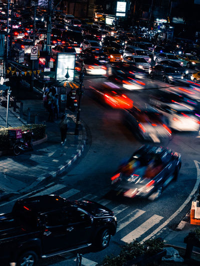 Blurred motion of vehicles on city street at night