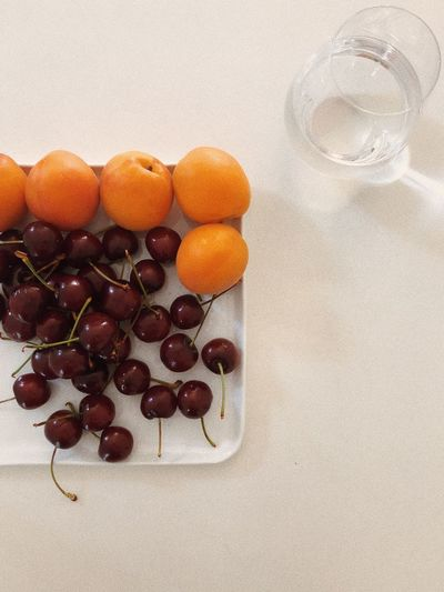High angle view of grapes in glass on table