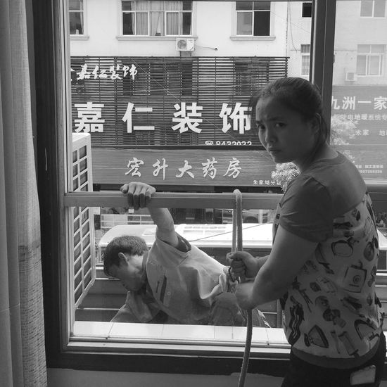 Showcase July Mobilephotography IPhoneography The Human Condition Monochrome Black And White Blackandwhite Working Window Working Hard The Street Photographer - 2017 EyeEm Awards