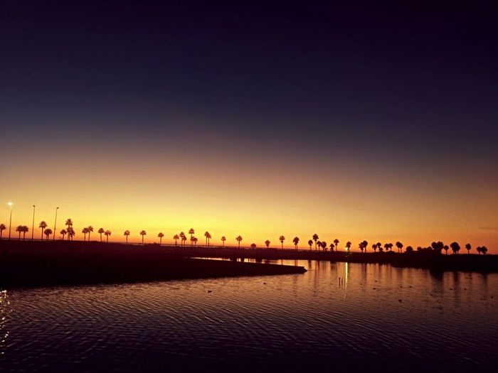 Sunset! Sunset Travel Destinations Reflection Silhouette Beauty Outdoors No People Arts Culture And Entertainment Architecture Sky Scenics City Multi Colored Nature Water Beauty In Nature Night Cityscape Urban Skyline Horizon Over Water