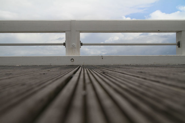 Boardwalk Built Structure Close-up Cloud Cloud - Sky Cloudy Day Diminishing Perspective Empty Nature Nieuwpoort No People Outdoors Pier Selective Focus Sky Surface Level The Way Forward Tranquility Wood Wood - Material Wooden