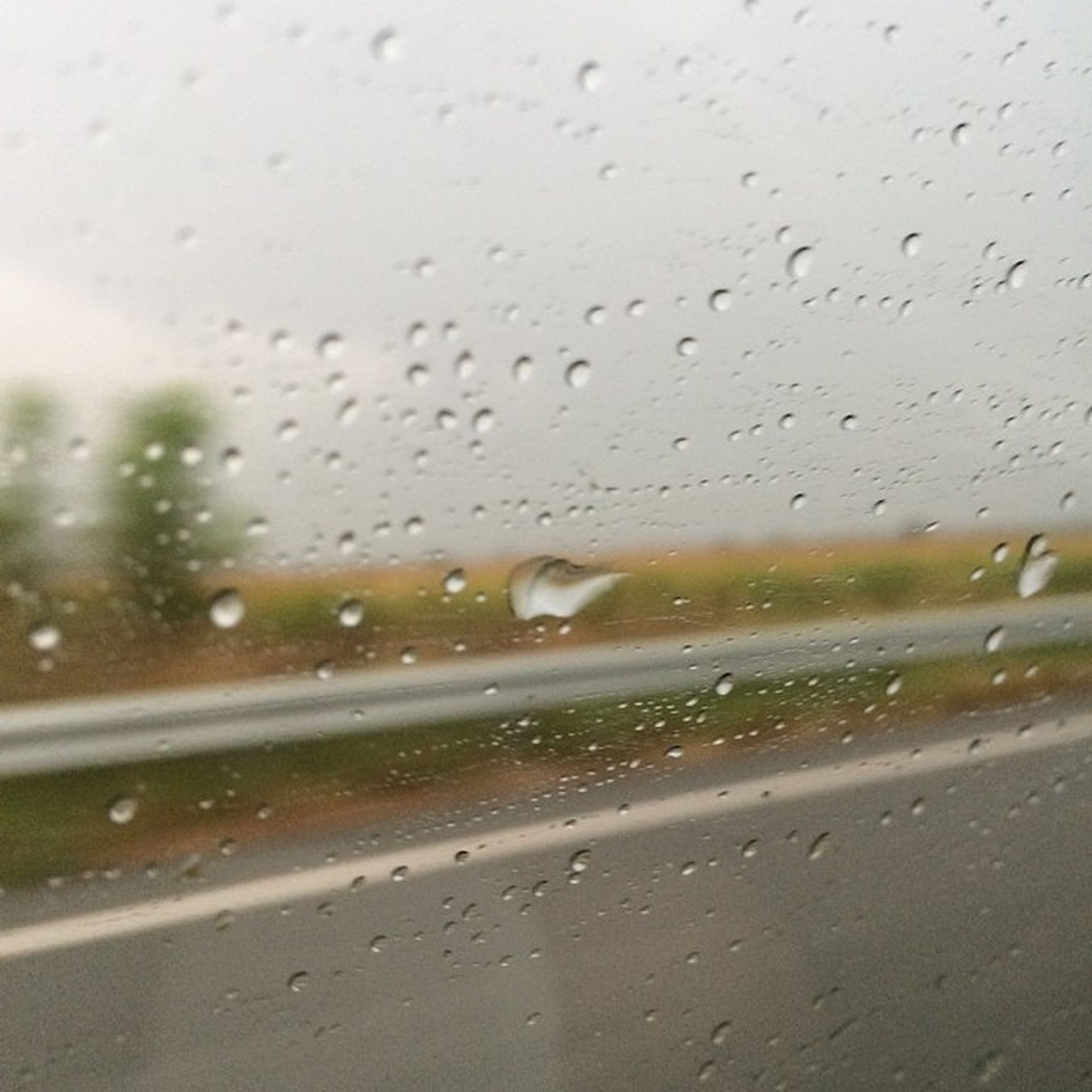drop, wet, window, transparent, glass - material, rain, water, transportation, raindrop, vehicle interior, weather, car, indoors, mode of transport, season, land vehicle, glass, car interior, windshield, sky