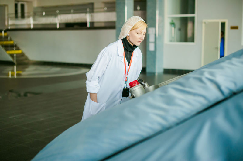 Close-Up Of Female Doctor Working At Hospital