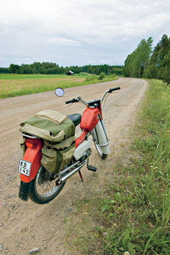 A Classical Finnish Moped A Country Road In Finland A Rest On Moped Trip An Adventure Day Landscape Motorcycle On The Road Outdoors Rural Scene Slowly But Surely Transportation Tunturi Moped What Next? With A Moped Throug Finland