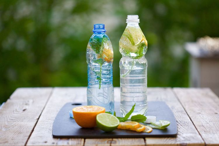 Bottle Citrus Fruit Close-up Day Drink Focus On Foreground Food Food And Drink Freshness Fruit Healthy Eating Healthy Lifestyle Homemade Lemon Nature No People Outdoors Picnic Ready-to-eat Refreshment SLICE Water Wood - Material