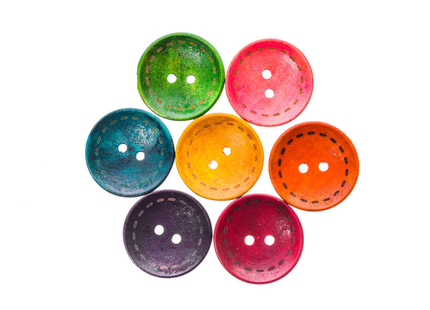 Different color round circular shaped sewing buttons in a flower shape. Arrangement Background Button Buttons Children Clothing Colorful Colors Creative Fashion Flower Handmade Heart Hobby Pallete Plastic Sewing Sewing Button Shadow Shape Shapes Texture Wood Wood - Material