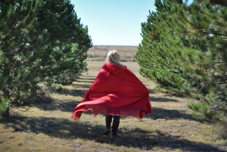 Cape  Red Red Riding Hood Fantasy Blonde Girl Woman Walking Walking Away Pine Tree Trees Forest Woods One Person Rear View Outdoors Flowing Full Length Tree Land Adult Hair Wind Breeze