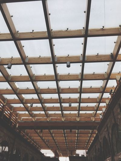 Sky Ceiling Low Angle View Indoors  Built Structure Architecture No People Roof Metal Wood - Material In A Row Architectural Feature Glass - Material Hanging Pattern Full Frame Roof Beam Day Lighting Equipment Building Sky